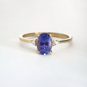 Elegant Oval Tanzanite and Petite Diamond Accent Yellow Gold Ring
