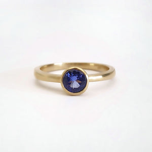Elegant Round Cut Bezel Set Solitaire Tanzanite Ring