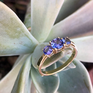 Elegant Trilogy Round Cut Tanzanite Ring