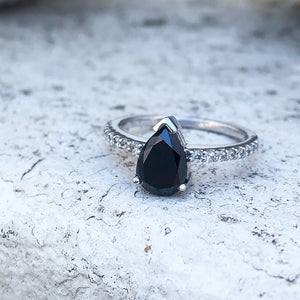 Elegant pear cut black diamond with diamond shoulder accented ring