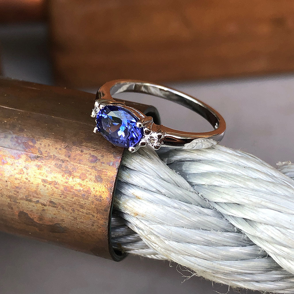 Exquisitely Deep Blue Oval Cut Tanzanite and Diamond Ring