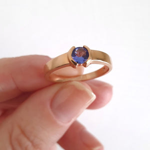 Half Bezel and Open Set Round Cut Tanzanite Ring