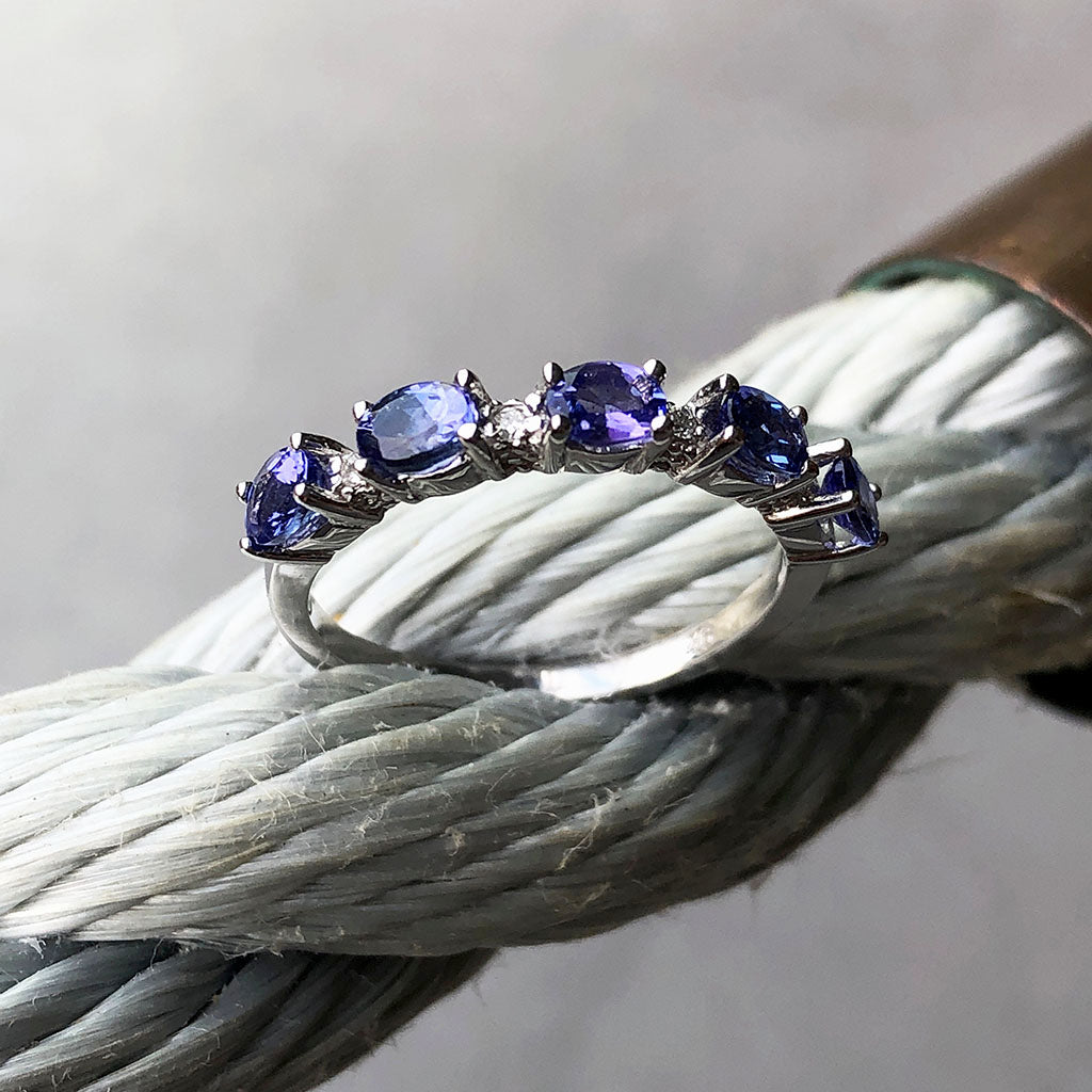Half Eternity Oval Cut Tanzanite and Diamond Highlight Ring