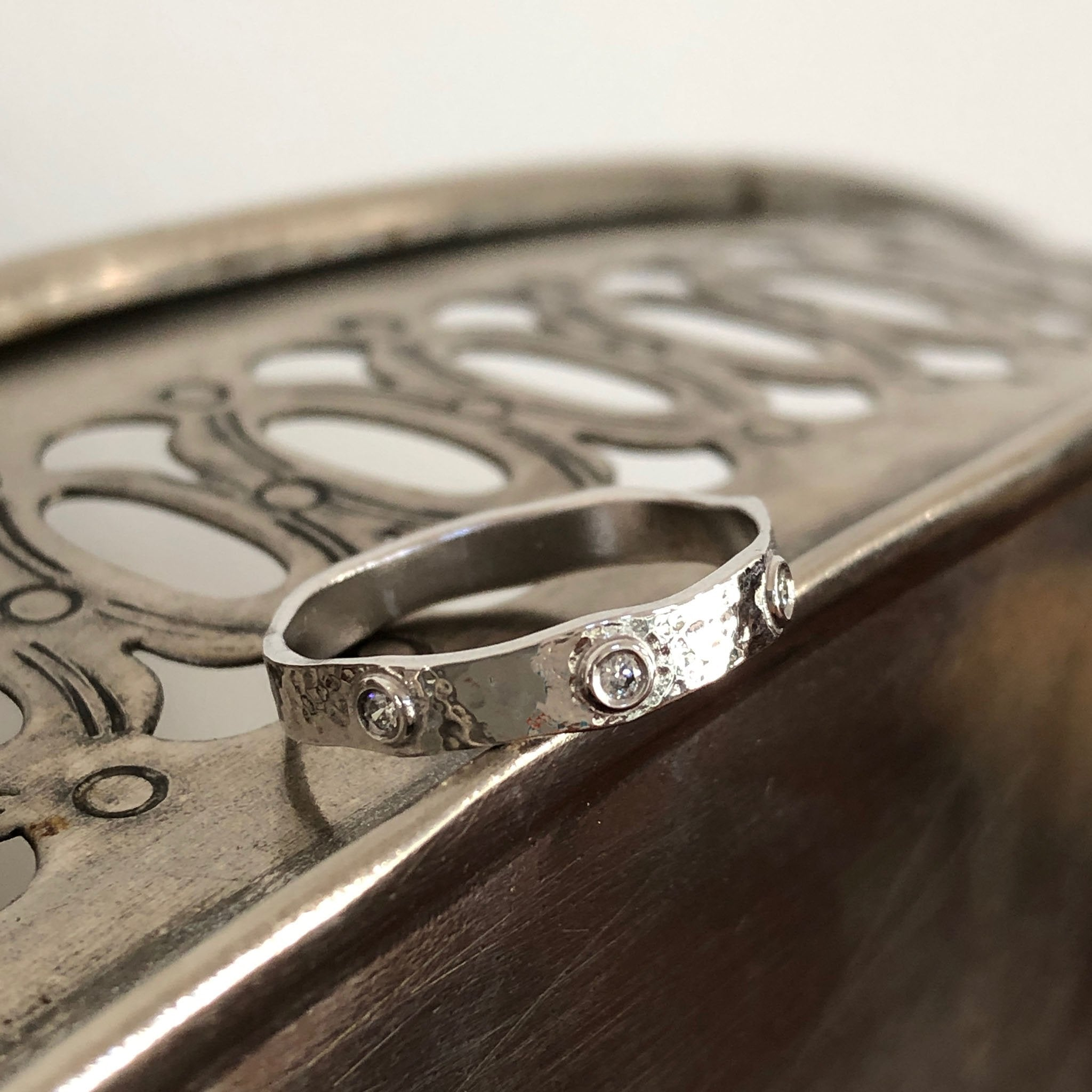 Handcrafted Diamond Studded Wedding Band in Hammered White Gold
