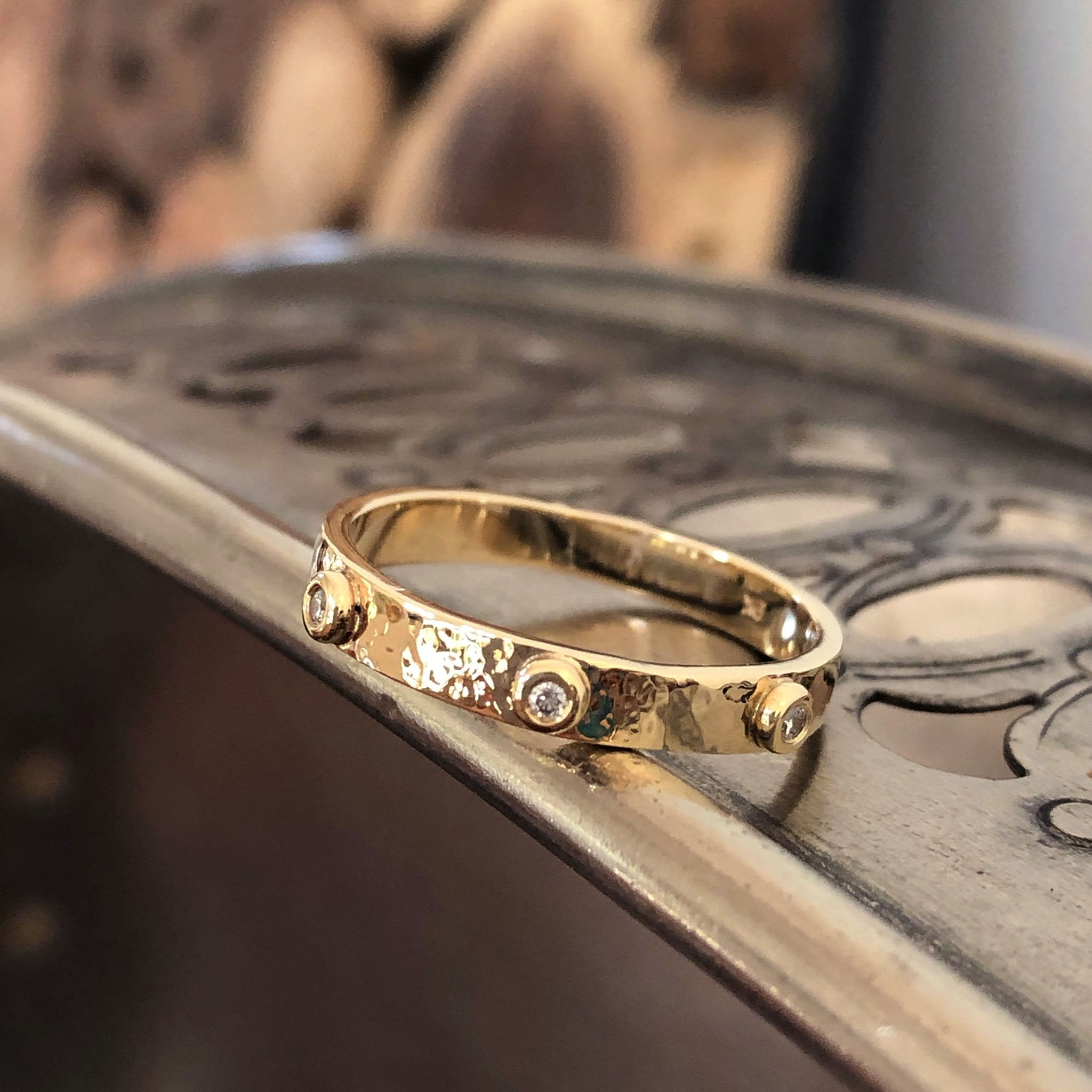 Handcrafted Diamond Studded Wedding Band in Hammered Yellow Gold