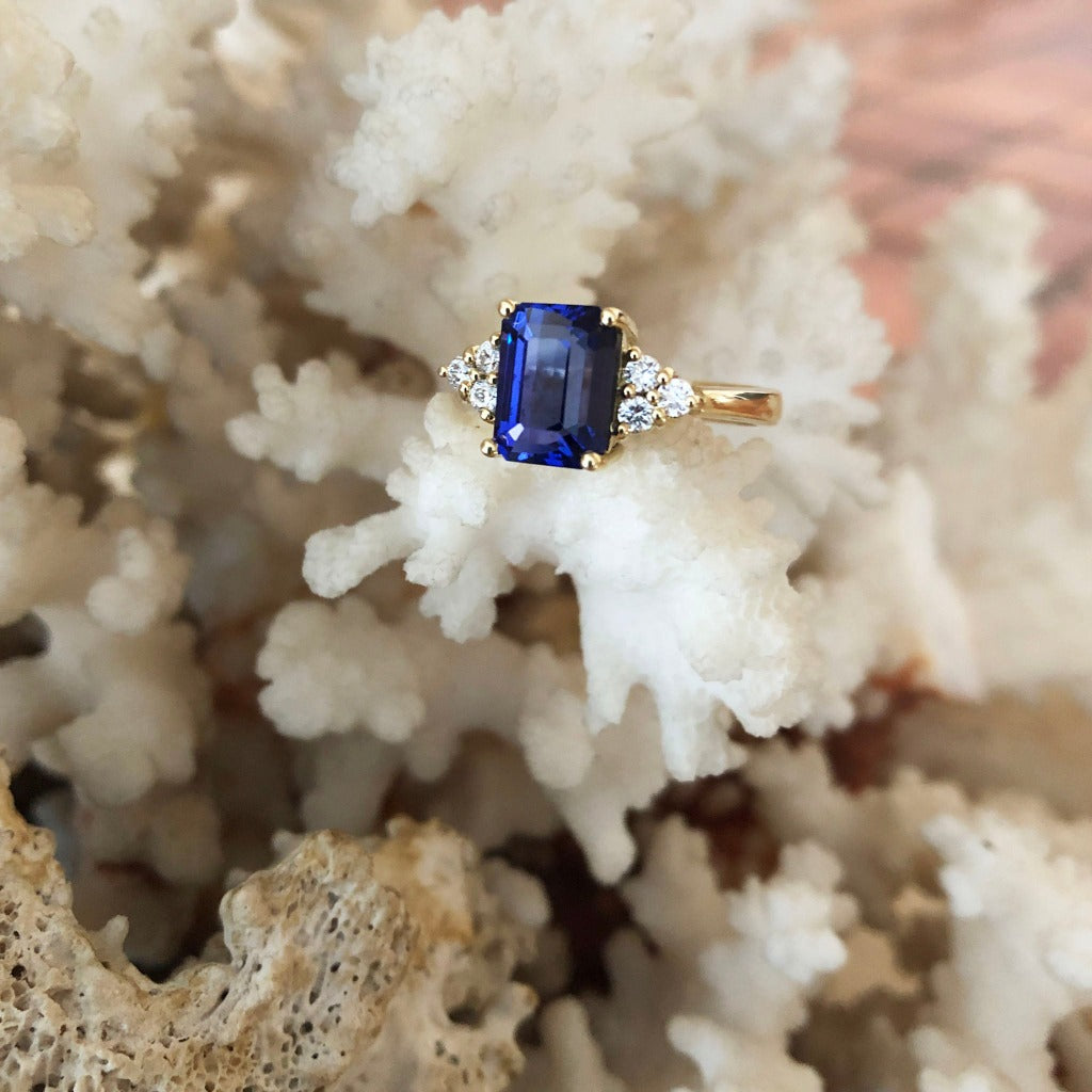 Handcrafted Emerald Cut Tanzanite Ring with Trilogy Diamond Accent