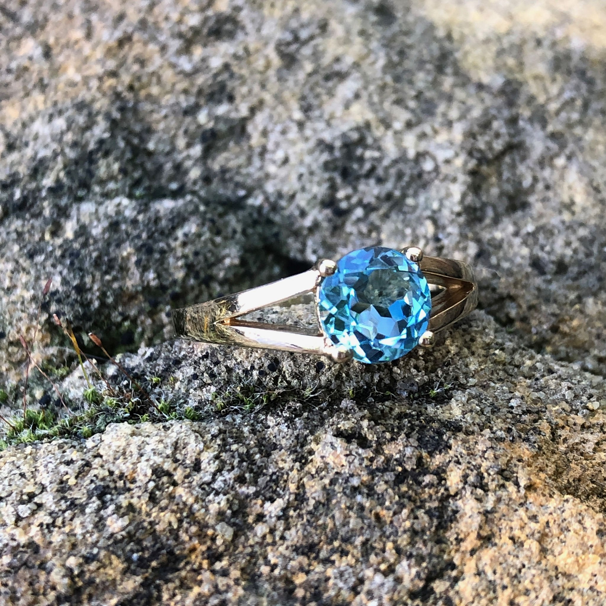 Solitaitre Round Cut and Claw Blue Topaz Yellow Gold Ring