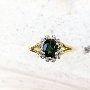 Oval Cut Green Tourmaline with Split Shank Yellow Gold Ring