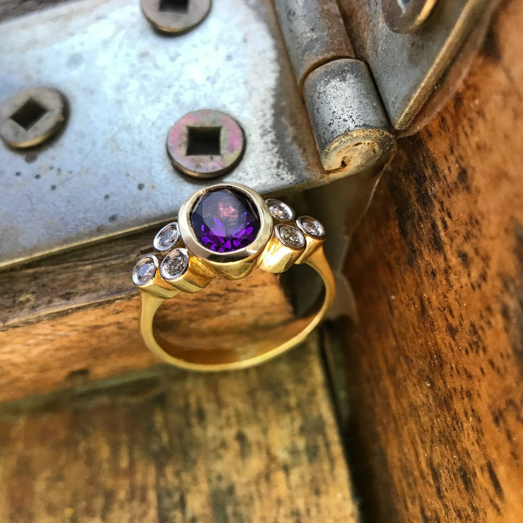 Oval cut Amethyst with Diamond trilogy accent ring