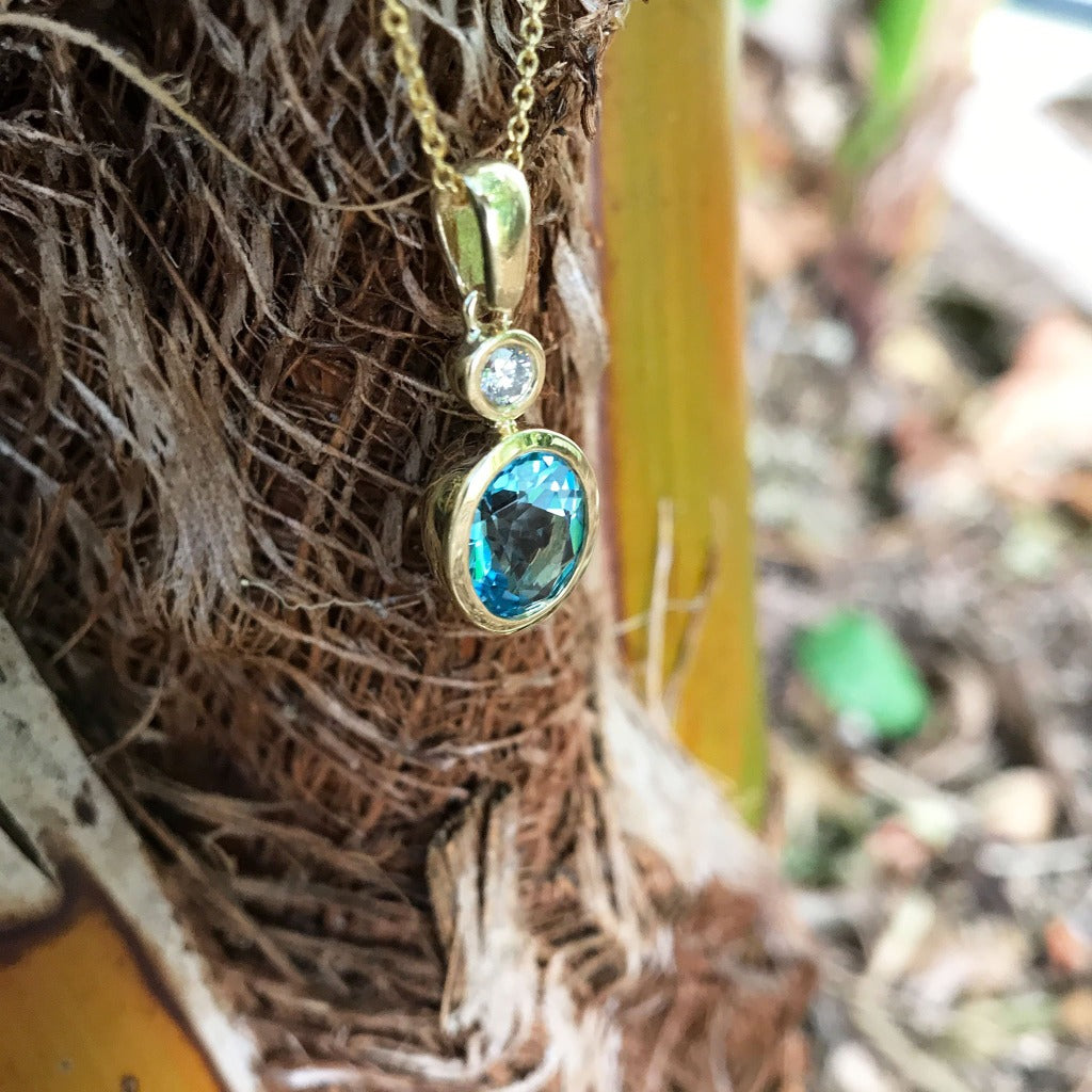 Blue Topaz, Diamond and Gold Pendant and Chain