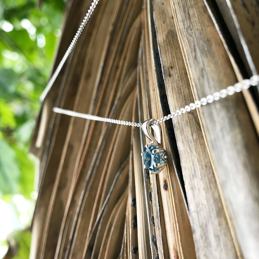 Elegant Round Cut Blue Topaz Pendant and Chain