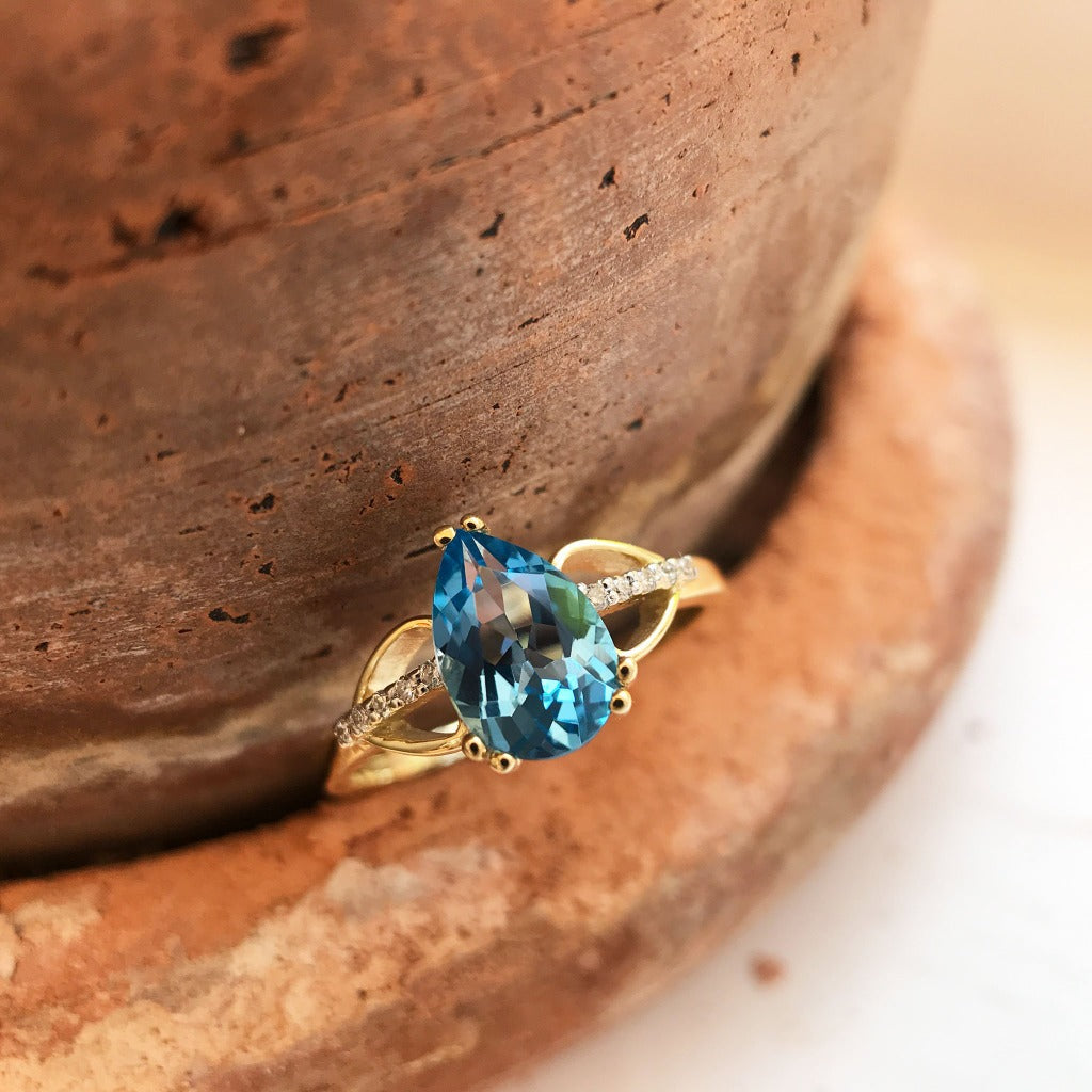 Pear Cut Topaz and Diamond Open Shoulder Ring