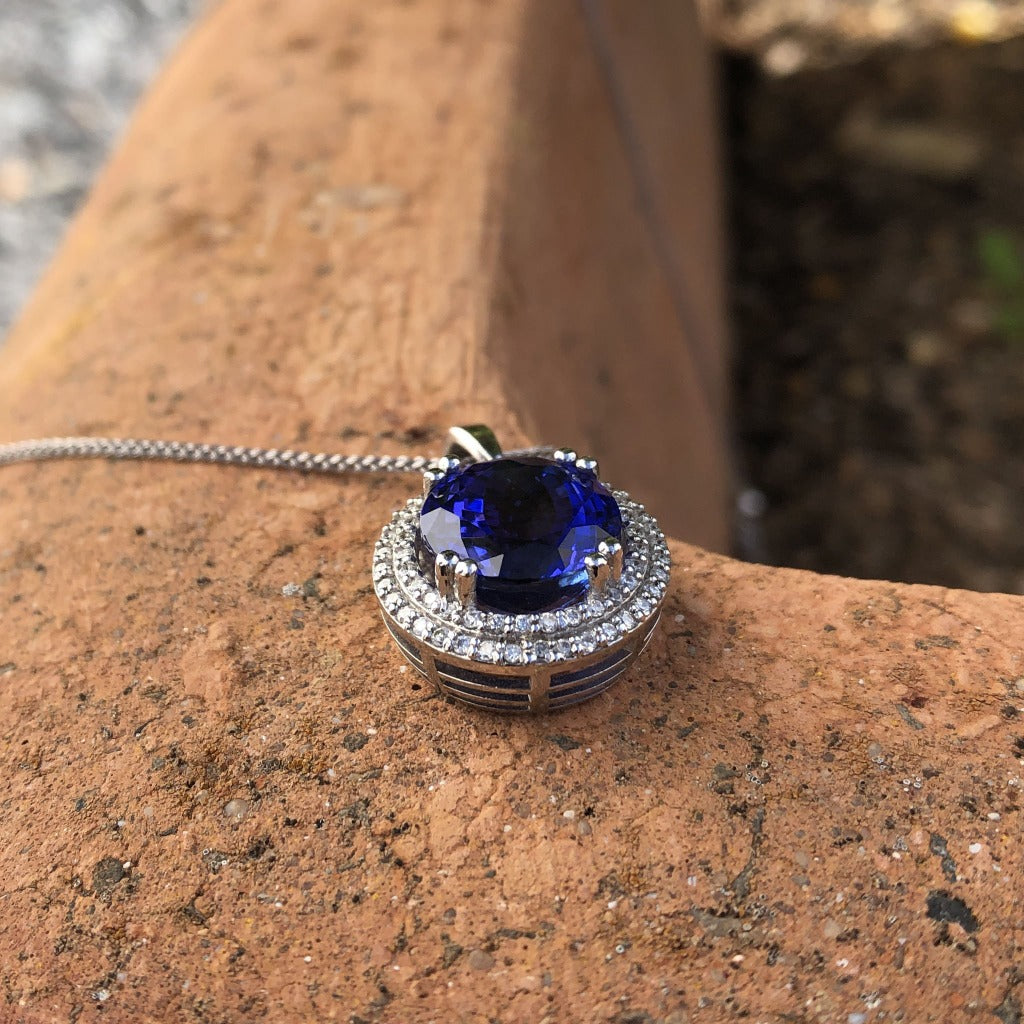 Scintillating Tanzanite and Double Diamond Halo Pendant