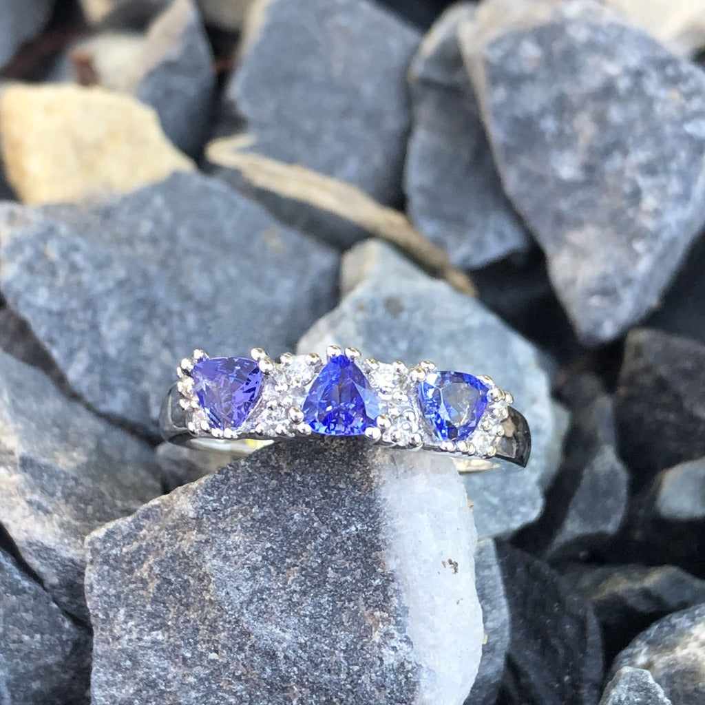 Three Trilliant Cut Tanzanite with diamond accent ring