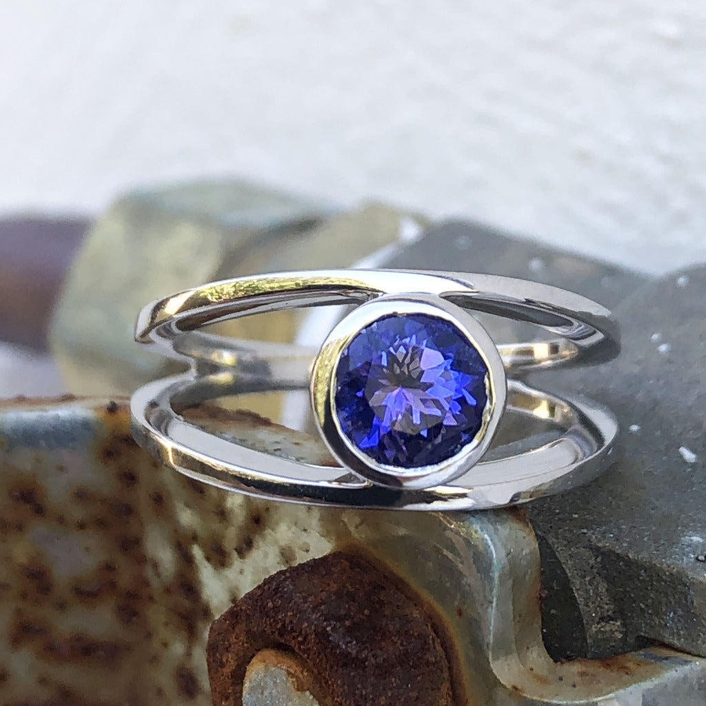 Tube Set Solitaire Tanzanite Set in a White Gold Split Shank Ring