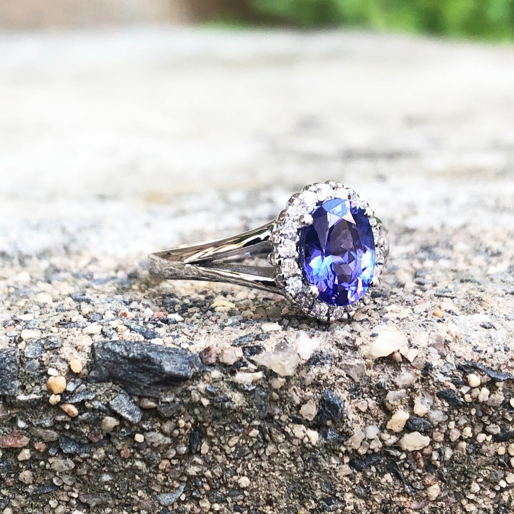 Oval Cut Tanzanite with Diamond Halo and Split Shoulder Ring