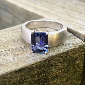 Handcrafted Unisex Emerald Cut Tanzanite Ring with Brushed Band Detail
