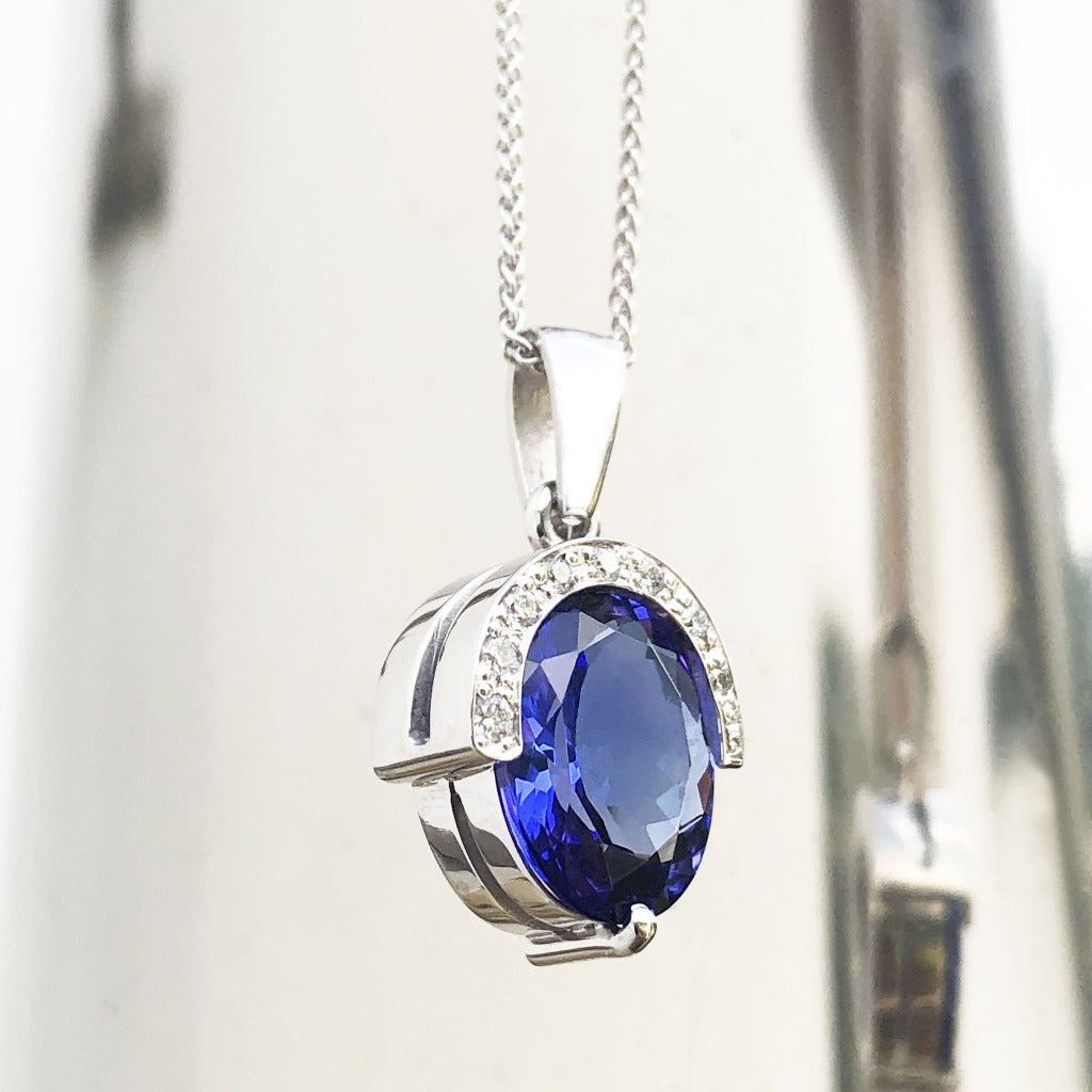Handcrafted Oval Cut Tanzanite Pendant with Flush Set Diamond Accents