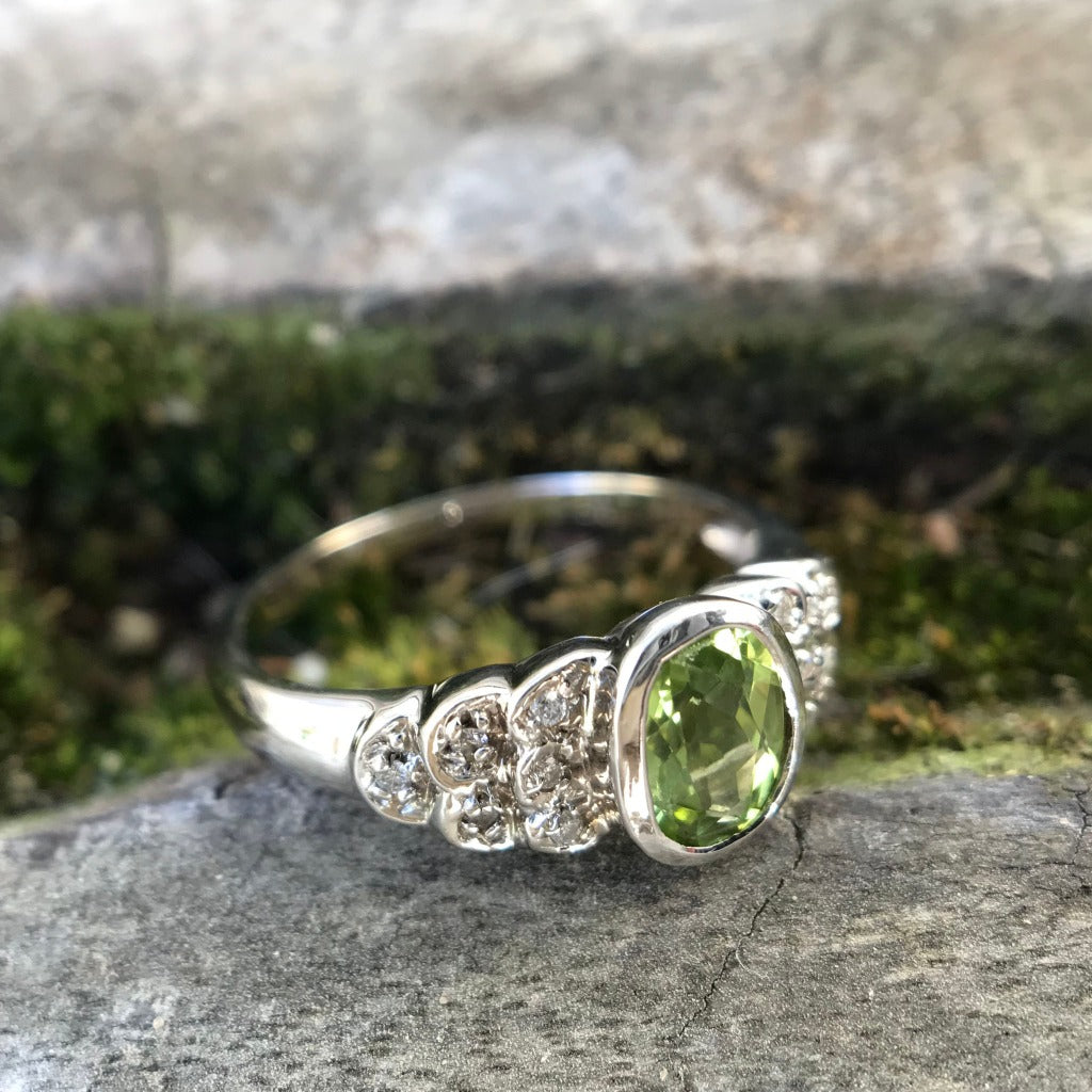 Ornate Oval Cut Peridot Ring with Diamond Step Detail