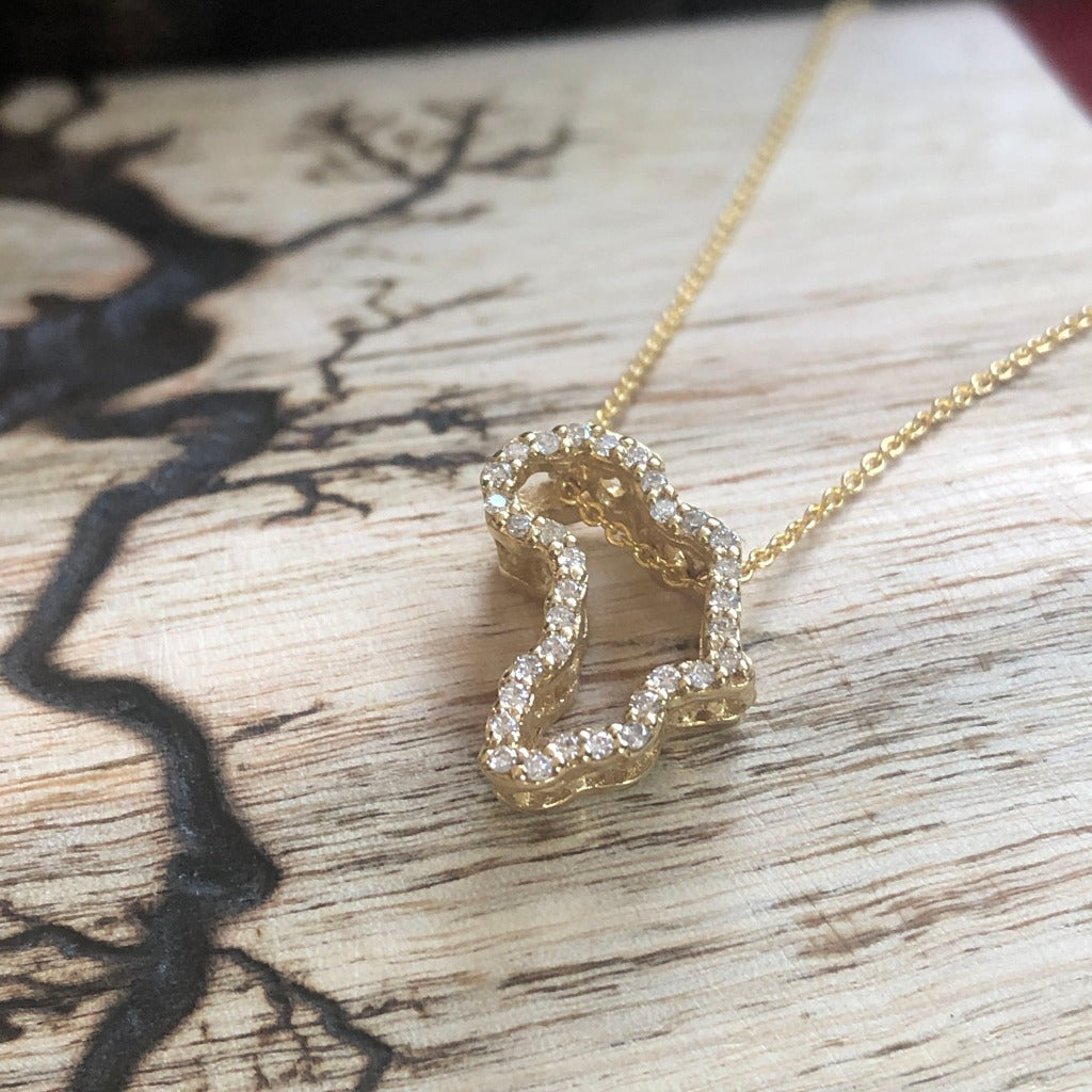 Diamond Studded 18-carat Gold Africa Pendant