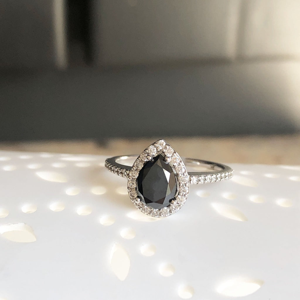 Pear Cut Black Diamond with White Diamond Halo