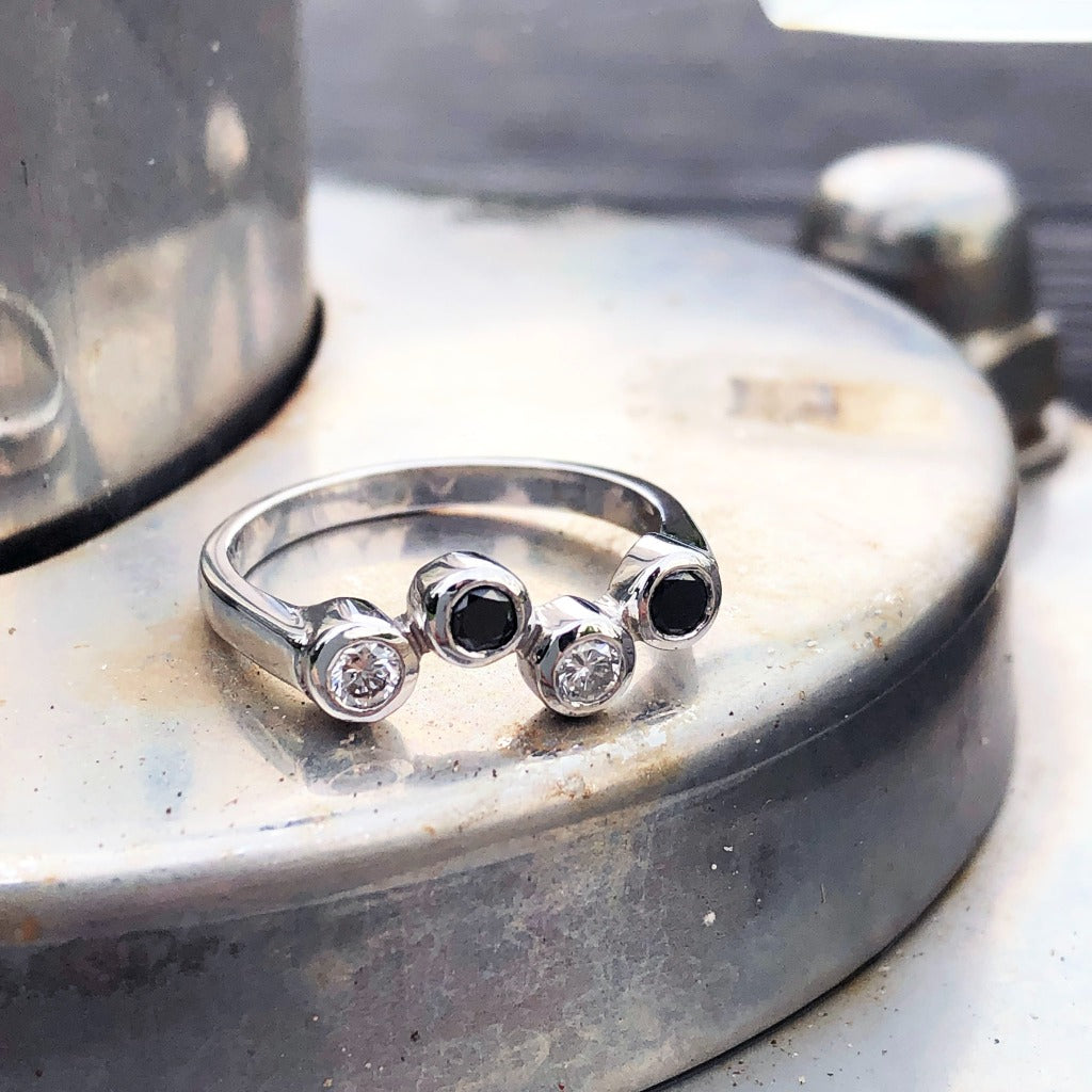 Alternating Black and White Tube Set Diamond Ring