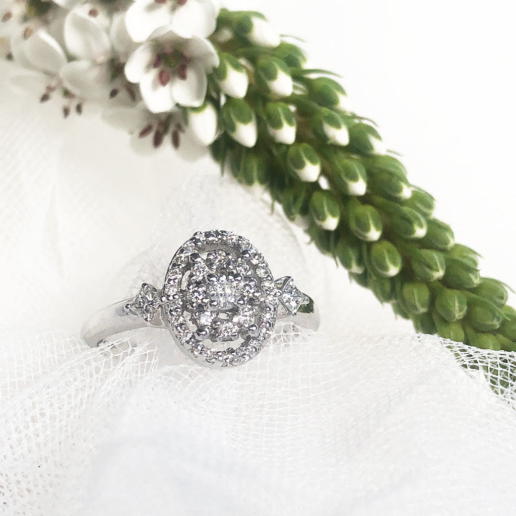 Oval Cluster and Diamond Shoulder Engagement Ring and White Gold Band Wedding Set