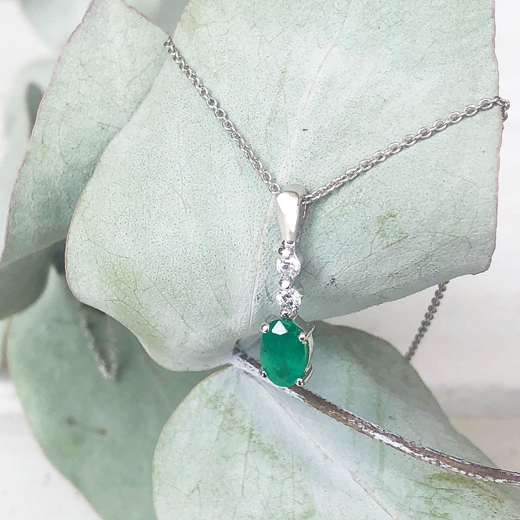 Oval Emerald and Double Diamond Pendant