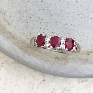 Oval Ruby and Double Diamond Accented Ring