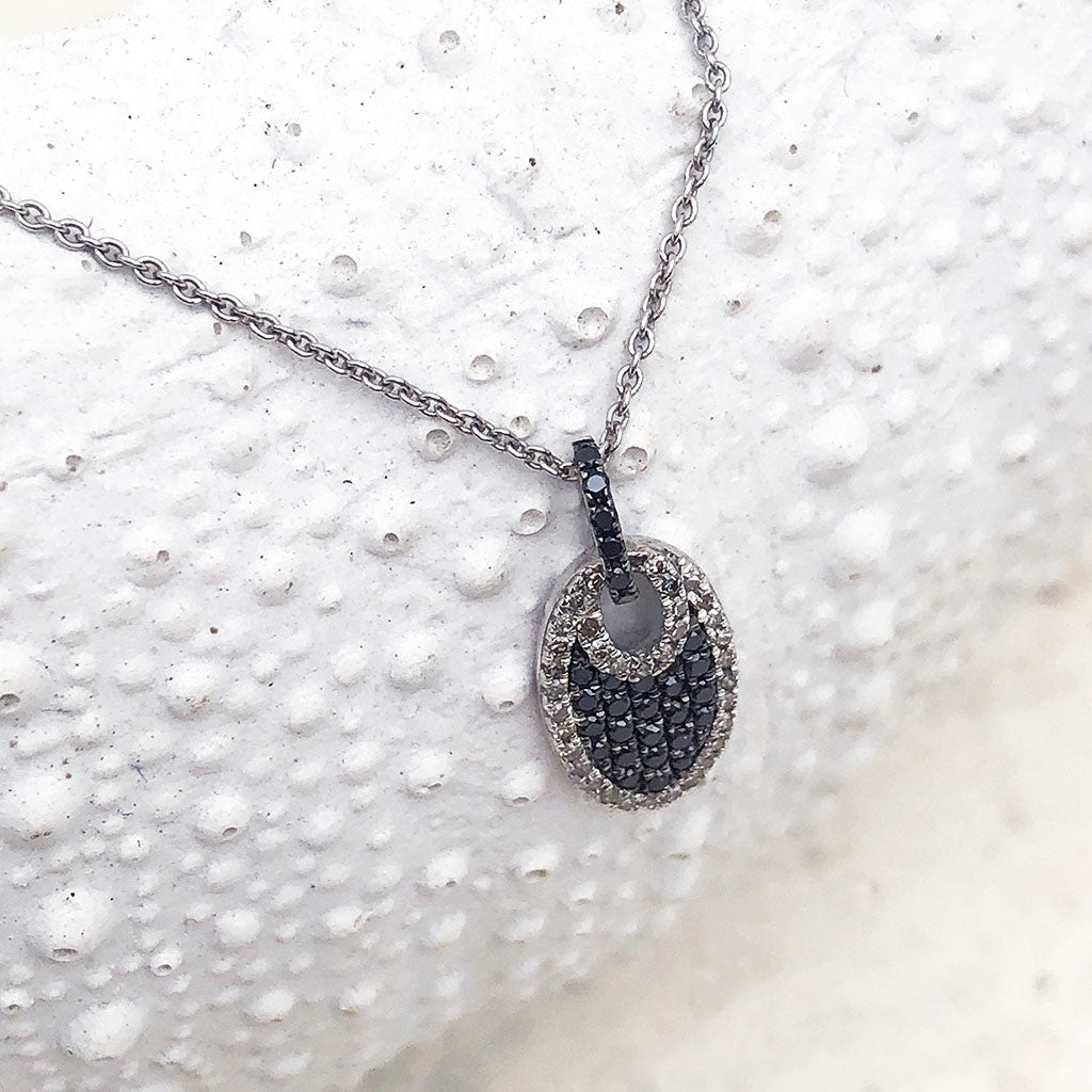 Petite Oval Black Diamond Pendant with a White Diamond Halo
