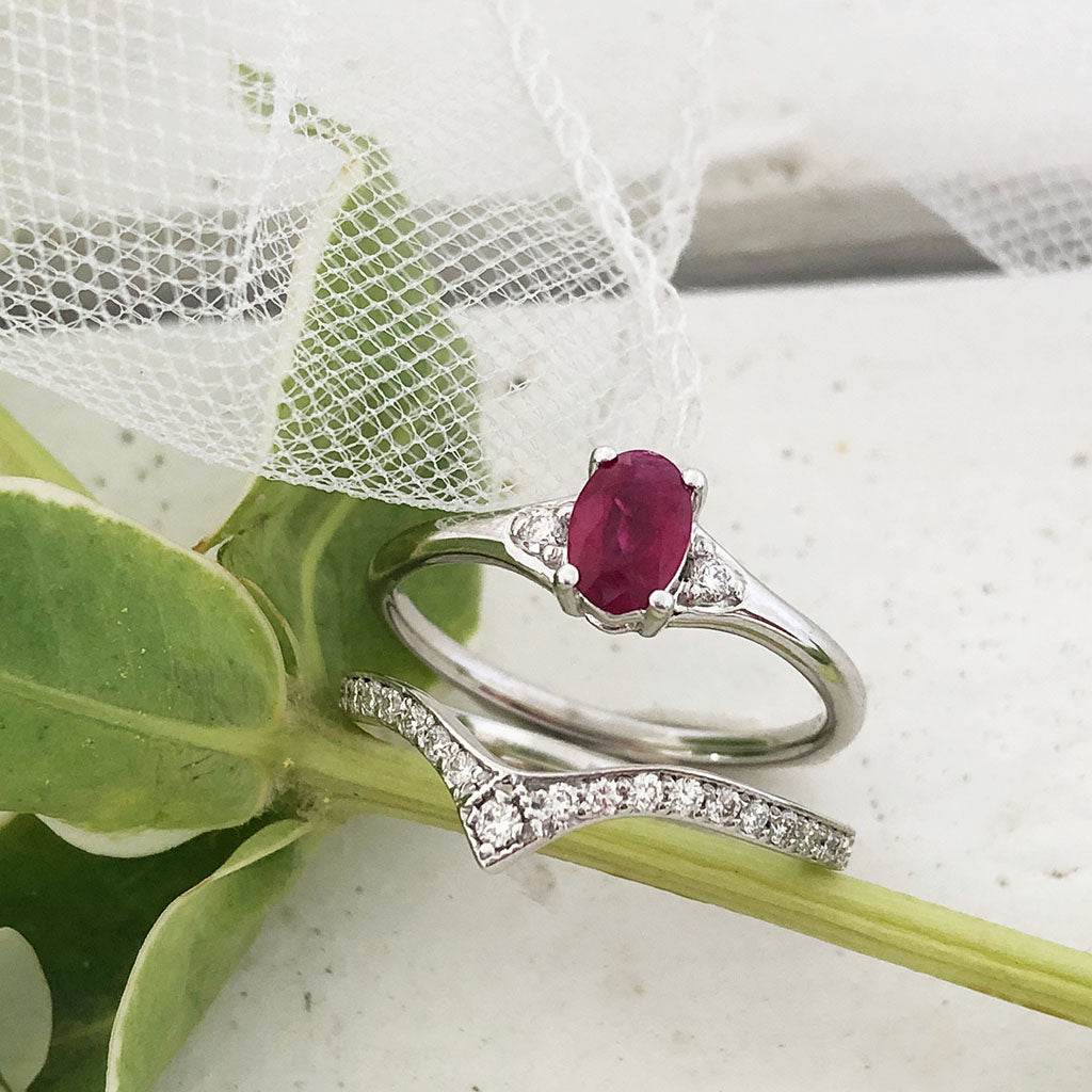 Petite Oval Ruby and Diamond shouldered engagement ring with 21 Diamond Crown Wedding Band