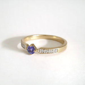 Petit Tapered Diamond Shoulder Tanzanite Yellow Gold Rin