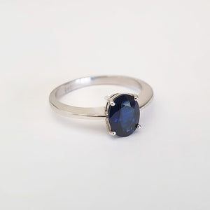 Solitaire Oval Faceted Four Claw Sapphire Ring
