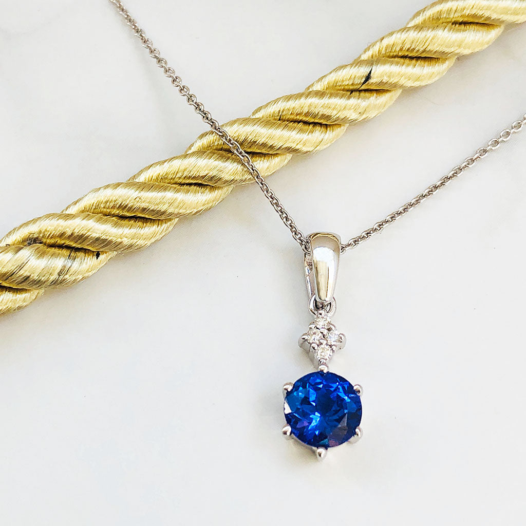 Stunning Four Diamond Accent Tanzanite Pendant