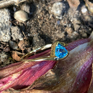 Trilliant Cut Blue Topaz and Yellow Gold Ring