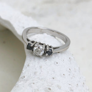 Trilogy Center White Diamond Ring with Black Diamond Accents