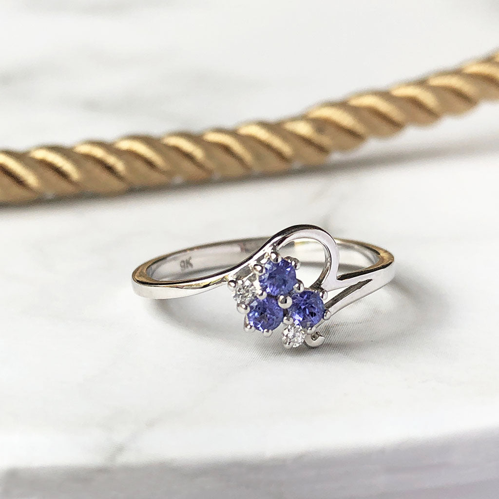 Trilogy Tanzanite and Diamond Cluster Ring