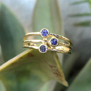 Triple Tanzanite Split Shank Yellow Gold