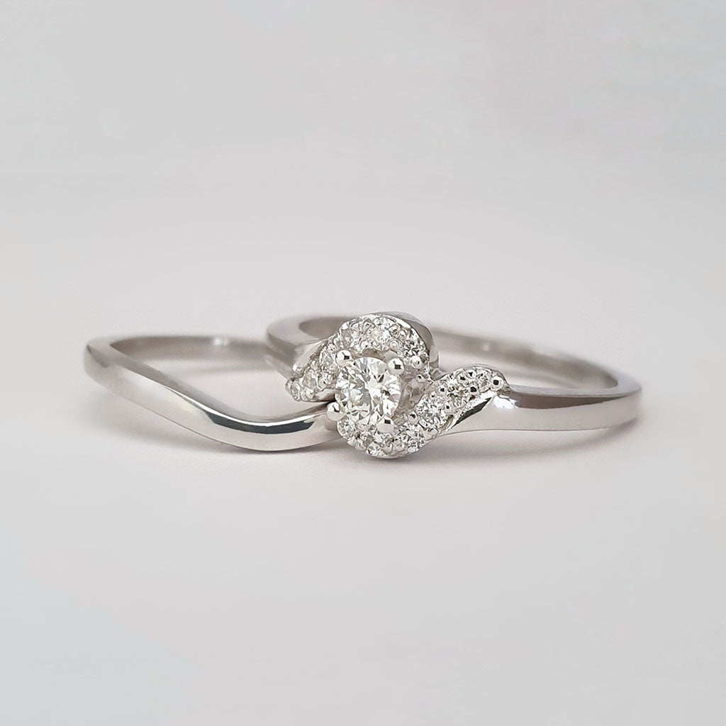 Twisted Shoulder Diamond Encrusted Engagement Ring and White Gold Wedding Set