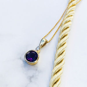 Yellow Gold Round Cut Amethyst with Diamond Accent PendantYellow Gold Round Cut Amethyst with Diamond Accent Pendant