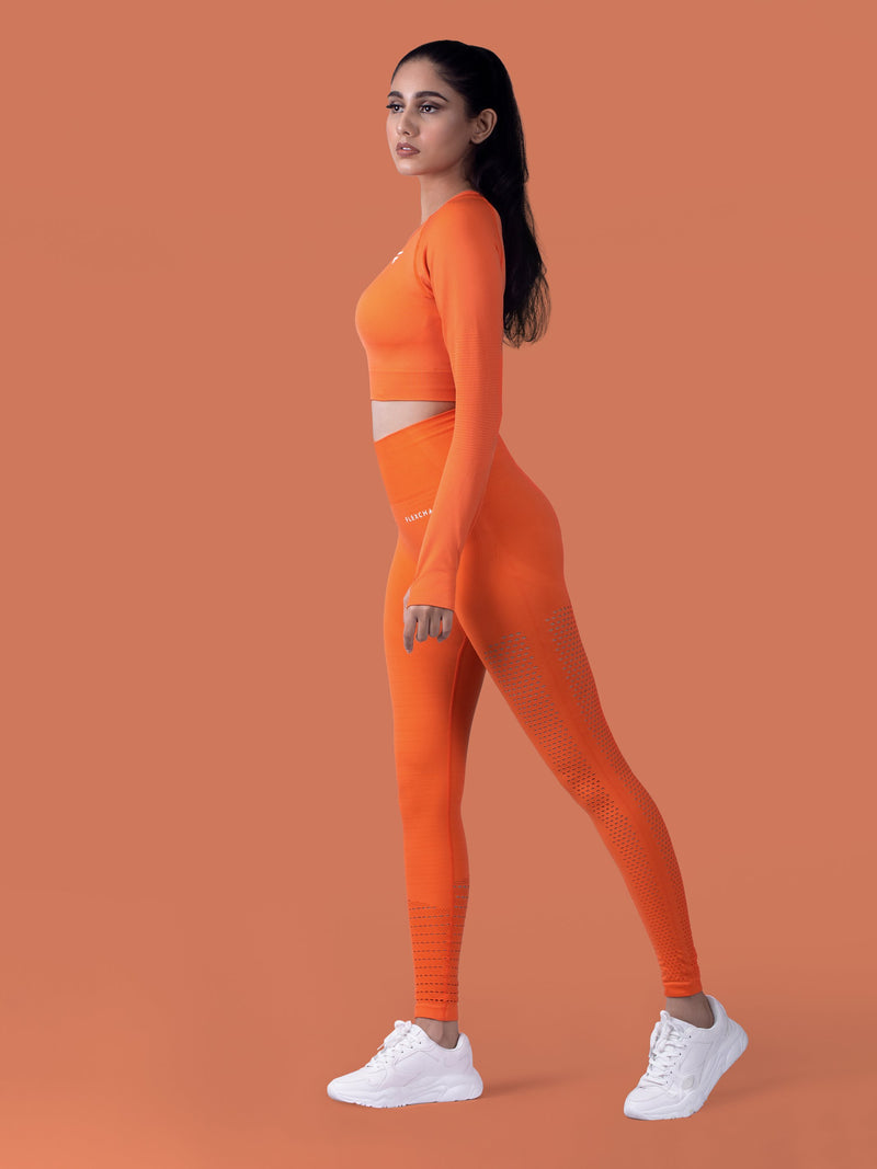 Motus Seamless Long Sleeve Crop Top - Orange - FLEXCHAMPS INDIA