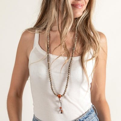 Woman wearing conch shell mala necklace