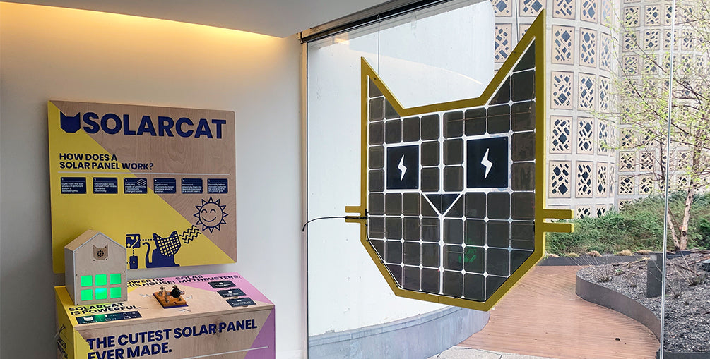Solar Cat by Grouphug. The cutest solar panel ever made. Custom shaped solar panel that powers a phone charging station.