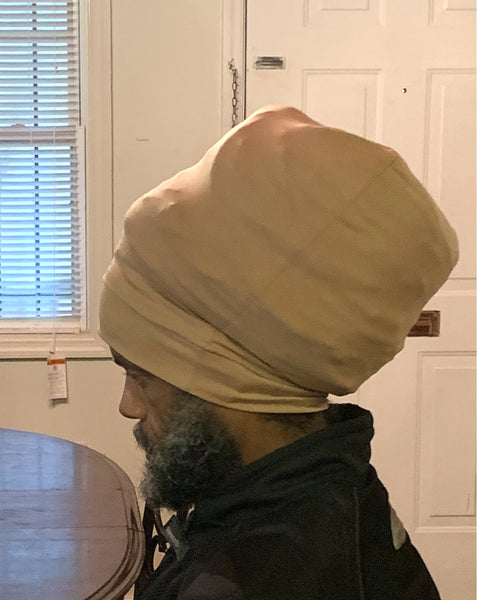 Tan stretch hat - side view.