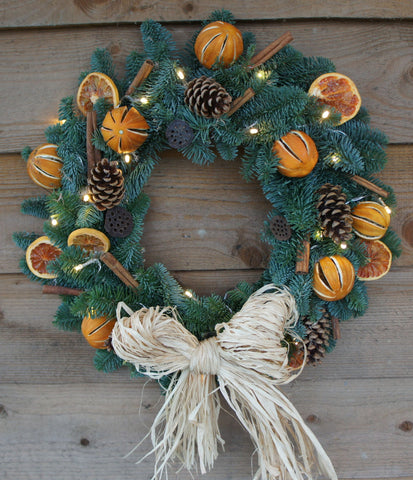 Oranges & cinnamon with raffia bow wreath.