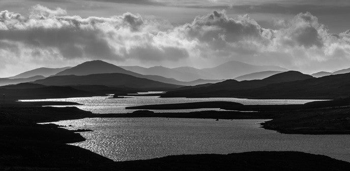 Black and White panoramic photograph of lochs on the Isle of Lewis