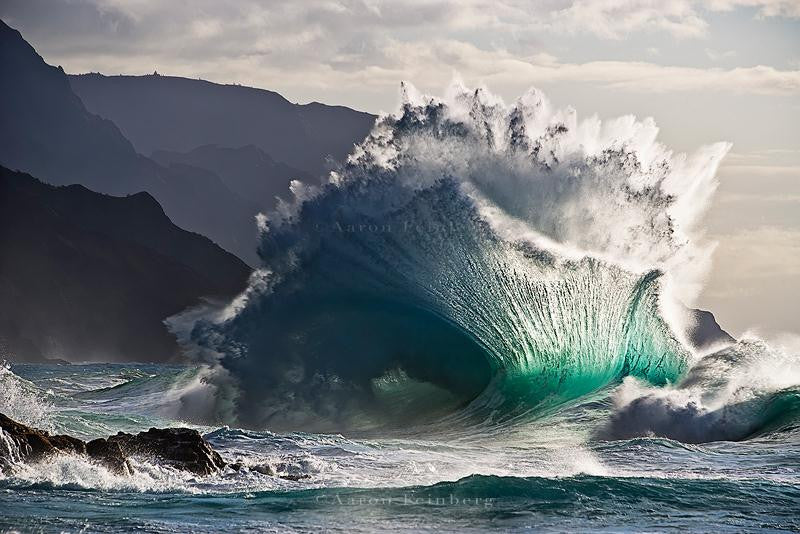 Stunning photographic shot of waves crashing on to rocks