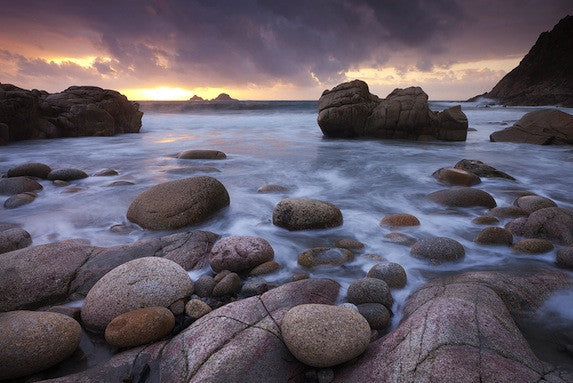 Long exposure image of water lapping on a stone beach at Boulder Cove