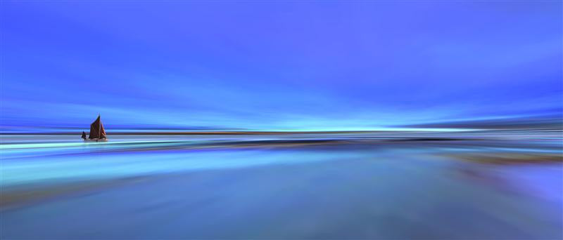 Stunning long exposure image of the beach in abstract blue