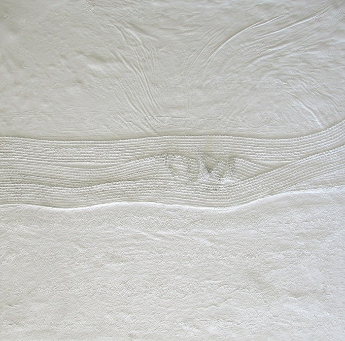 Abstract painting in white cement